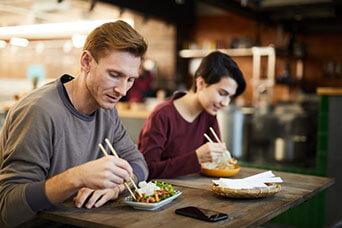 people_enjoying_chinese_food